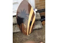 Wooden Skimboard from Lush Longboards , as new. Great fun for the beach