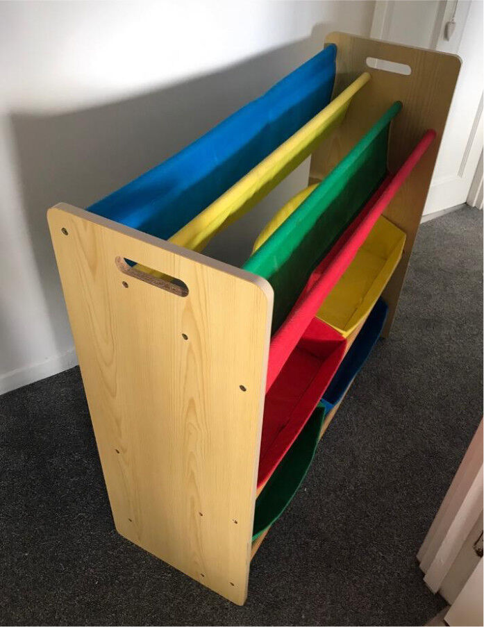 Toy storage with book sling