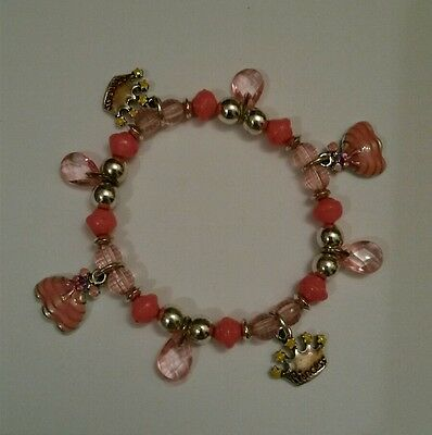 Used~Pink and Silver Toned Beaded Child Stretch Bracelet With Princess Charms