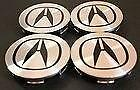 BRAND NEW NEVER MOUNTED ACURA CENTER CAP SET OF FOUR.