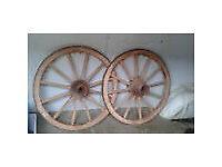 a pair of vintage wooden cart / wagon wheels with metal rims 28 inches dia