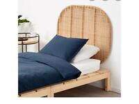 A pair of IKEA rattan headboards