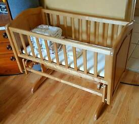 Solid wood crib, rocking with mattress and bumpers