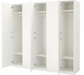 4 door IKEA Pax Wardrob white in very good condition. Can be fitted as 2 + 2 or all 4 together.