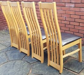 4 dining chairs, wooden frame, brown leather padded seats. Excellent clean condition