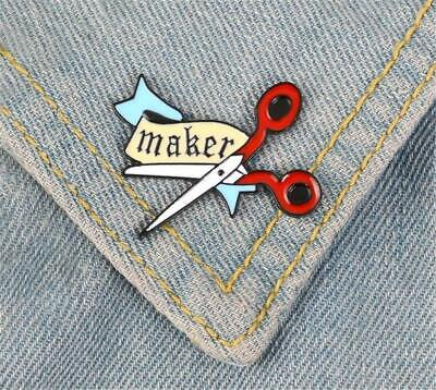 CG4235...ENAMEL LAPEL PIN - SCISSORS & BANNER