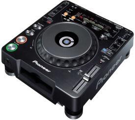 Pioneer CDJ 1000 mk3 (pair) with a Numark DMX09 mixer and headphones