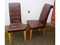 2 Brown leather high back dining chairs