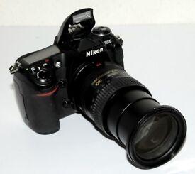 Nikon D300 Camera + Nikon 18-200 mm Lens