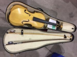 Violin in case. Needs strings. Very good condition. $100