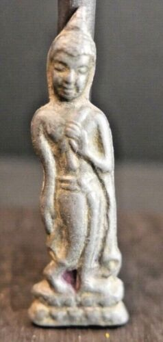 Antique Buddhist Thai Amulet...posing in the