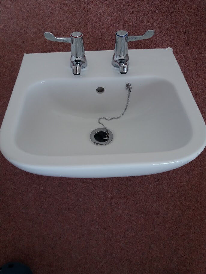 White Cloakroom /Bathroom basin with two lever taps and ...