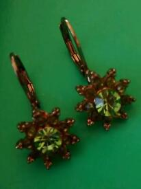 Rose gold coloured earings with green peridot