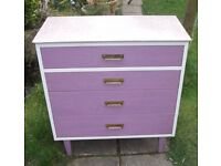 Retro formica topped white and pink-purple chest of drawers.