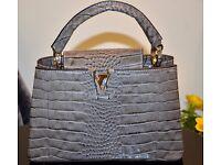 Crocodile skin handbag