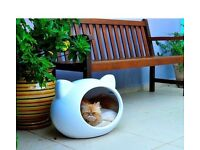Cat shaped white cat house