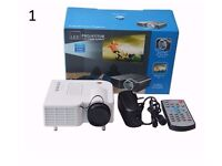 LED Minimulitmedia Projector with built in speakers