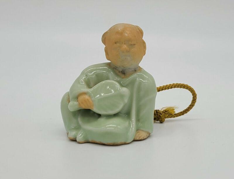 Japanese 19c Meiji Period Green Hirado Porcelain Netsuke of Child with Fan