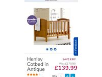 Henley Cotbed. Used but good condition. Converts easily from 1st cot to toddler bed. +mattress