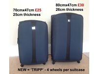 2 new 'Tripp' Suitcases never used with 4 wheels per suitcase