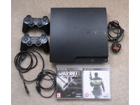 Sony PS3 Model CECH-3003B console with 2 controllers with leads and 2 games.