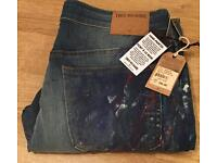 Brand new with tags authentic hand painted men's True Religion jeans. Waist 34. Mick super slim fit