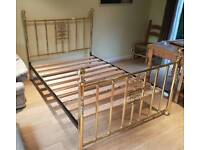 A rather special double brass bed with mother of pearl inlays