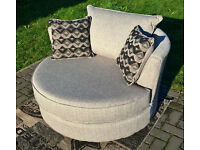A New Designer Oatmeal Fabric Material Swivel Arm Chair.
