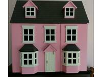 Doll house with furniture and family