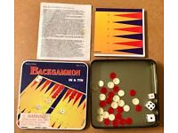 Backgammon In A Tin Travel Game. Complete And Good Condition.