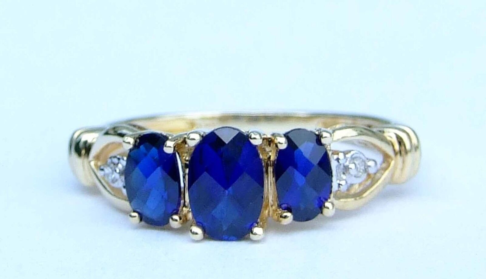 Ladies three oval checkerboard cut blue sapphire ring for Man made sapphire jewelry