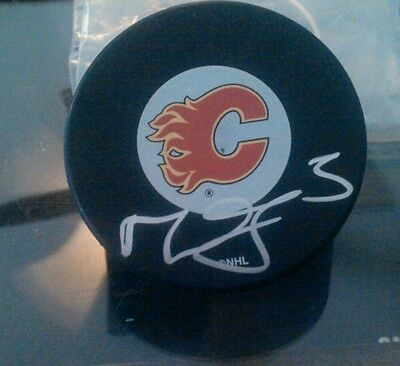 Autographed Calgary Flames Hockey Puck (Mark Giordano Signed Calgary Flames Hockey Puck)