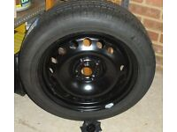 FULL size car tyre with steel rim.