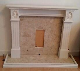 White wooden fire surround mantel