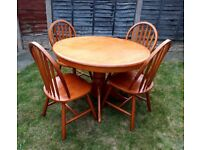 Round farmhouse/country style dining table and 4 chairs - can deliver locally.