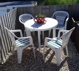White plastic table and 4 chairs