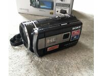 Sony HD digital video camera recorder. Model HDR-PJ200E with built in Projector