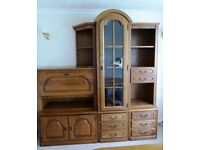 Wall unit and cocktail cabinet in medium oak finish, plus two matching display shelves