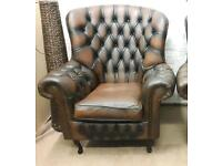 Antique brown Chesterfield wingback armchair. Delivery available