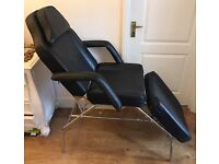 Beauty couch/chair, head hole and arms, in black, can be used as chair or flat as massage couch