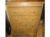 USED STURDY CONDITION, A NICE PINE EFFECT CHEST OF 4 (Does have chip top middle back