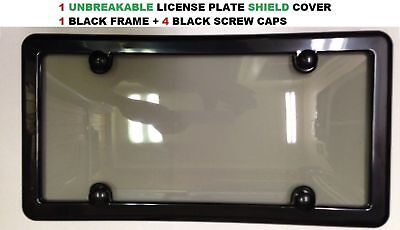 UNBREAKABLE TINTED SMOKE LICENSE PLATE SHIELD COVER  BLACK FRAME  4 SCREW CAPS