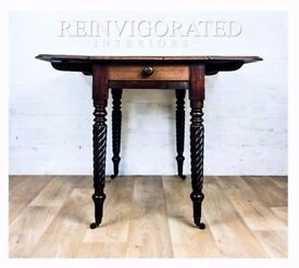 Twisted legs drop leaf table