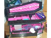 Monster High coffin with doll and car