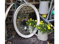 Vintage ornate bevelled edge oval mirror