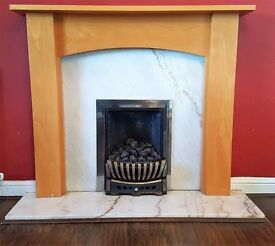 Traditional gas fire with contemporary fire surround and marble hearth