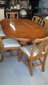 Yew immaculate extendable dining table and 6 chairs