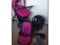 Silvercross wayfarer in raspberry, comes with carry cot and second seat, rain over too.