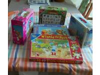 Five different children puzzles for age 2-5.Includes three floor puzzles. Three Winnie the Pooh.
