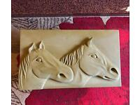 Sandstone relief carving of horses